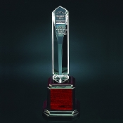 "The AC-A950 Acrylic Obelisk Award is mounted on a rosewood base. Available in 3 sizes: 12""H, 13""H, 14""H"